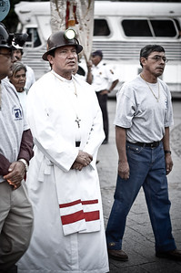 A priest leads a group of miners during a parade in Guanajuato, Mexico.