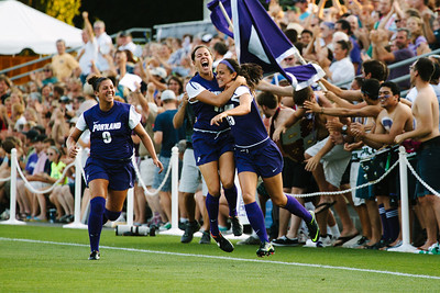 University of Portland women's soccer team celebrates after scoring a goal to beat North Carolina.