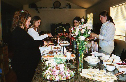 Loading up on incredible food at my book club baby shower -- look at that spread! April 2005