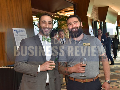 Eli Rabinowitz from sponsor Pioneer Bank, left, and Liam Bancroft from Toshiba Business Solutions.