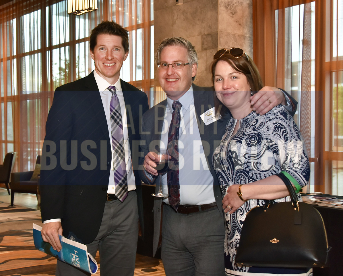 Jason Abare from eBizDocs, left, with Philip Schwartz from Behan Communications and Sara Egan from Mazzone Hospitality.