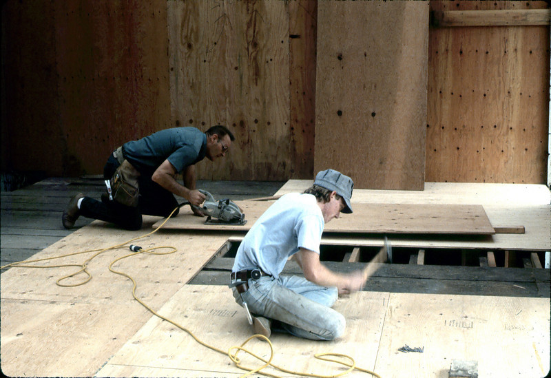 """""""Paul"""" and Bob Mowry installing Freight Room flooring, 6/1982. acc2005.001.0248"""