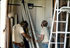 Apprentice carpenters remove paneling in Baggage Room, 4/3/1982. acc2005.001.0198