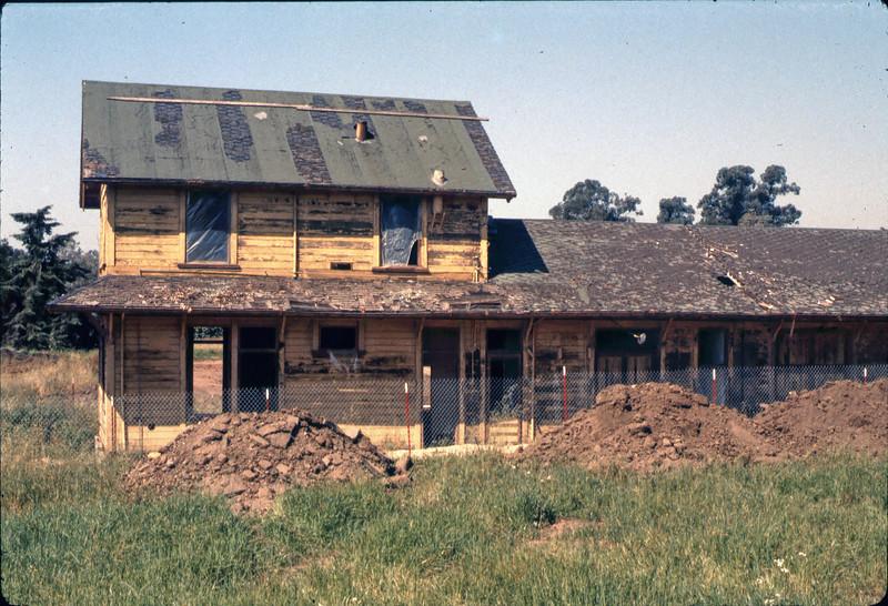 Foundation back-dirt piles, 5/1982. acc2005.001.0212