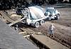 Pouring the perimeter sidewalks, 10/1982. acc2005.001.0341B
