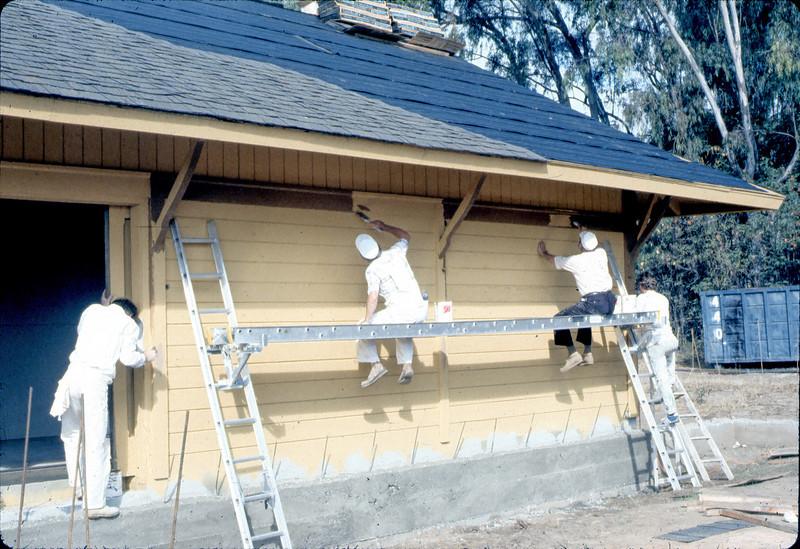 Painter's Union men return to apply trim, 9/1982. acc2005.001.0310