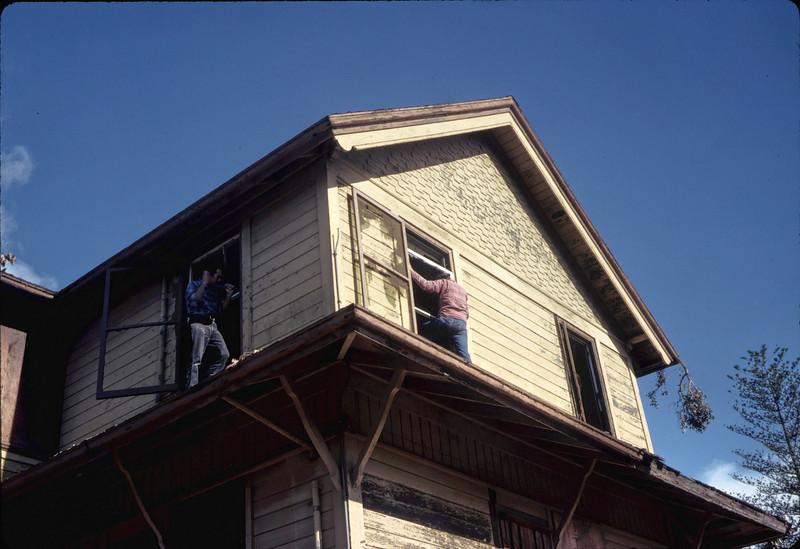Window & screen removal. Michael Glassow (left), 11/28/1981. acc2005.001.0124