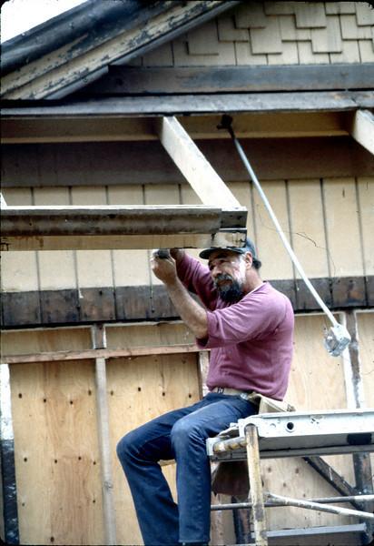 "Carpenter ""Louie"" rebuilding eave, 6/1982. acc2005.001.0225"
