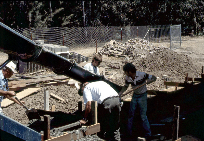Pouring foundation for new freight dock, 8/1982. acc2005.001.0282