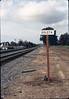 New railroad station sign at depot site, Jan. 1982. acc2005.001.0135