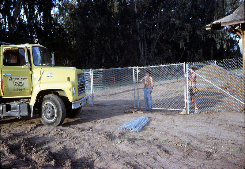 Perimeter security fence goes up, 11/21/1981. Larsen Fence. acc2005.001.0120
