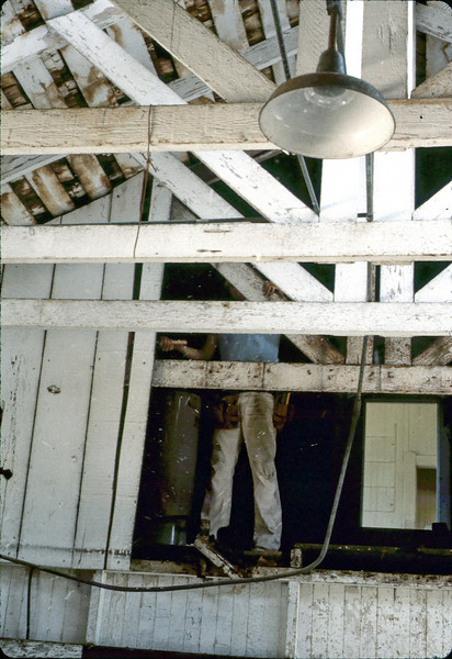 Removing water heater from upper floor, 4/3/1982. acc2005.001.0200