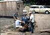 Bob Hiestand repairing generator, 6/1982. acc2005.001.0245