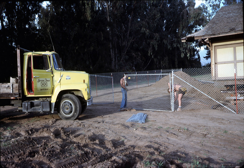 Perimeter security fence goes up, 11/21/1981. Larsen Fence. acc2005.001.0119