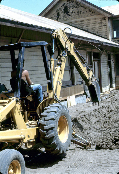 Trenching for loading dock footings, 7/1982. acc2005.001.0265