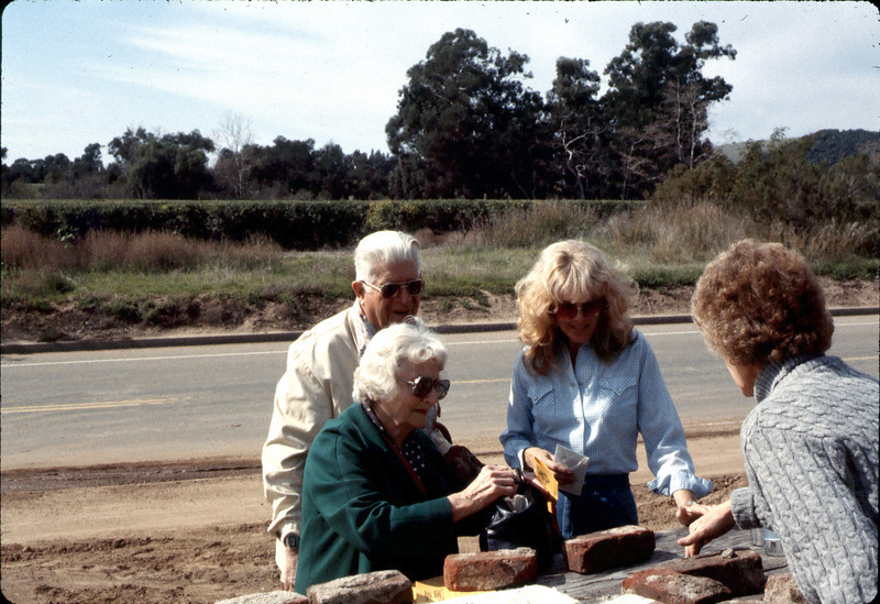 Ike and Joy Bonilla buy Depot bricks from Phyllis Olsen and Nancy Ried, Feb. 1982. acc2005.001.0164