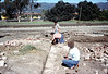 Salvaging bricks from old depot site, 11/19/1981. Nancy Ried (front), Mary Lou Williamson. acc2005.001.0108