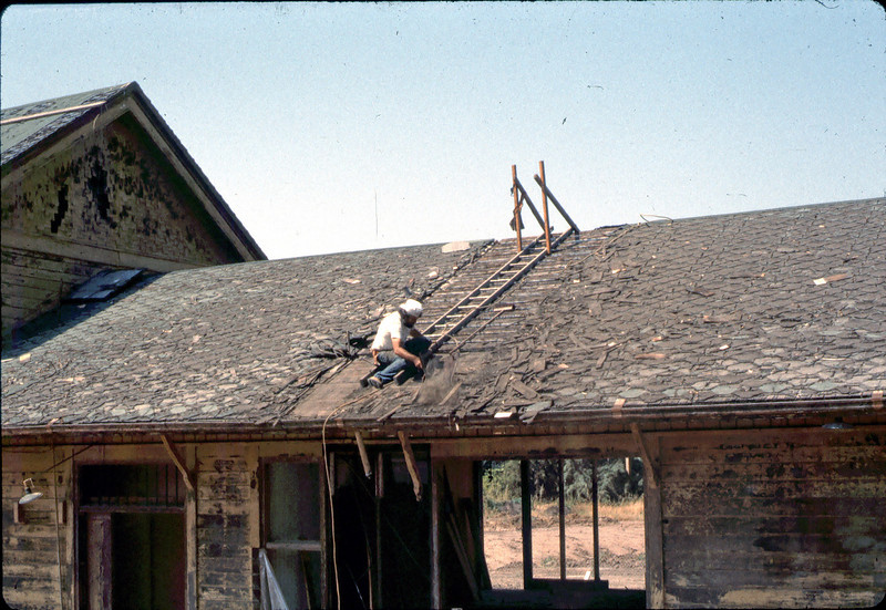 """Removing old roof (""""Charlie""""), 6/1982. acc2005.001.0220"""