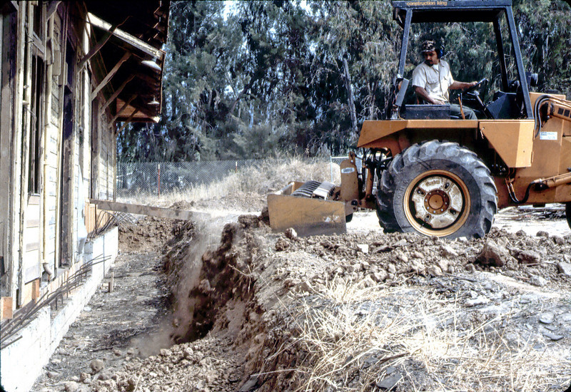 County worker backfills foundation, 6/1982. acc2005.001.0259