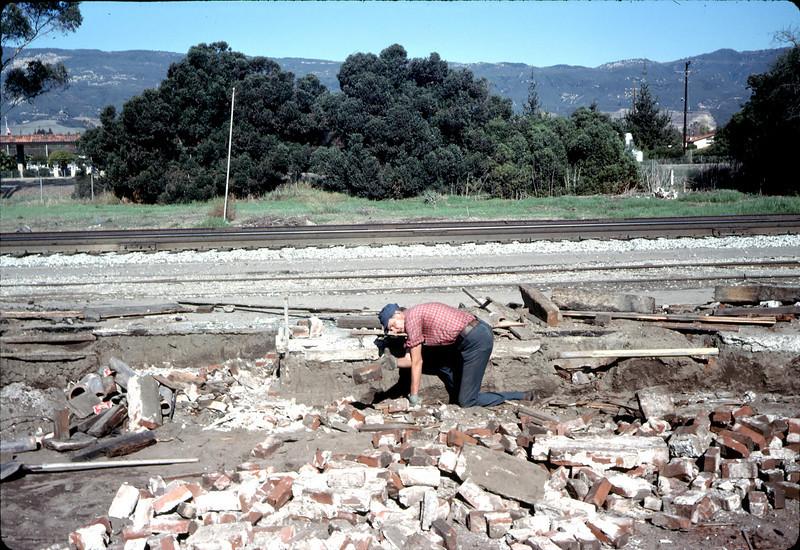 Salvaging bricks from old depot site, 11/19/1981. Gene Allen. acc2005.001.0107