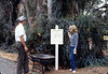 Ralph Moore and Phyllis Olsen install a direction sign for the museum grounds, 8/1983. acc2005.001.0398