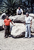 Gary Coombs, Jesse Garcia, and Al Jaramillo pose in front of the rock that will bear the Native Sons plaque at Goleta Depot, 8/1983. acc2005.001.0396