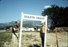 Ray Baird, Ralph Moore installing street sign, Spring 1983. acc2005.001.0348