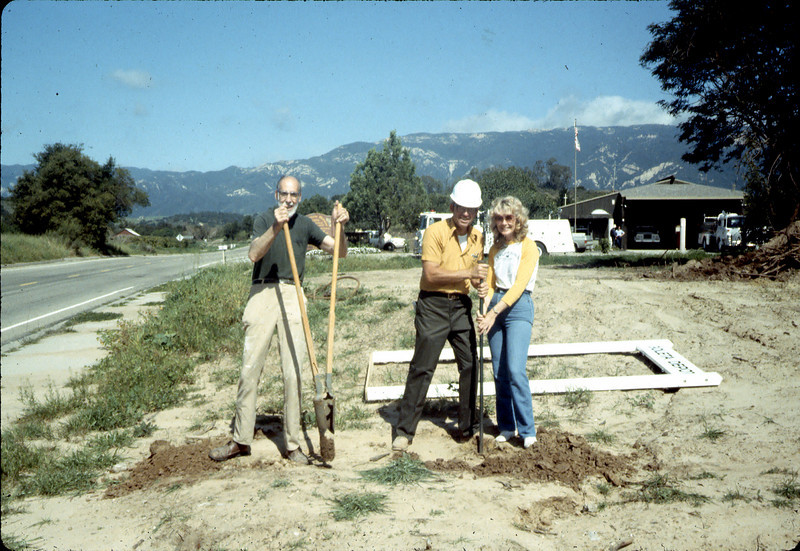 Ray Baird, Ralph Moore and Phyllis Olsen installing street sign, Spring 1983. acc2005.001.0345