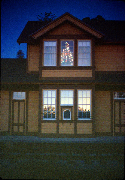 Goleta Depot front exterior with Christmas tree in upstairs bay, 12/1988. acc2005.001.1020