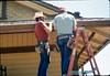 M&M Construction installs new redwood gutters, 5/1988. acc2005.001.0972