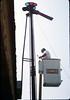 Bill Battisone, OK Tree Service, installs ladder on train-order pole, Work Day, 4/9/1988. acc2005.001.0924