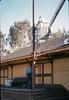 Bill Battisone, OK Tree Service, installs ladder on train-order pole while Gene Allen supervises, Work Day, 4/9/1988. acc2005.001.0920