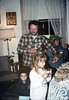Doug Conrow & children at Goleta Depot holiday party, 12/1987. acc2005.001.0886