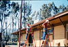 M&M Construction installs new redwood gutters, 5/1988. acc2005.001.0973