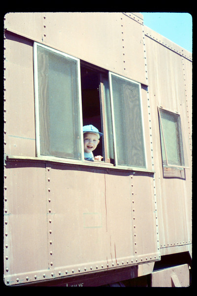 At the museum on the 4th of July (Robert Adams in caboose), 7/4/1990. acc2005.001.1380