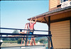 M&M Construction installs new redwood gutters, 5/1988. acc2005.001.0966