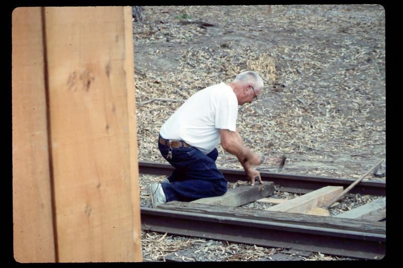 Elmer Coombs works on handcar loading/transfer platform, 7/1990 acc2005.001.1386
