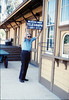 Gene holds replica Western Union telegraph sign where original once hung on Goleta Depot, 5/1989. acc2005.001.1161