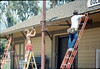 M&M Construction installs new redwood gutters, 5/1988. acc2005.001.0957