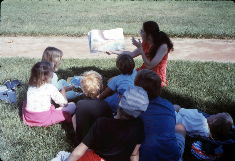 Goleta Librarian Judy Savage holds storytime during Simi Valley rail trip for Summer Reading Program, 1989. acc2005.001.1205