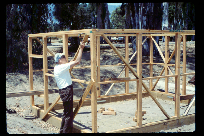 Gene Allen frames the miniature-train shed, 6/1990. acc2005.001.1348