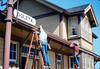 M&M Construction installs new redwood gutters, 5/1988. acc2005.001.0976