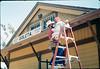 M&M Construction installs new redwood gutters, 5/1988. acc2005.001.0971