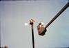 Bill Battisone, OK Tree Service, installs ladder on train-order pole, Work Day, 4/9/1988. acc2005.001.0921
