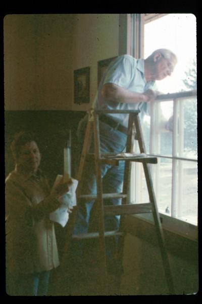 Hilda Volkman and Paul Conover wash windows, 2/1991. acc2005.001.1451