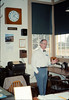Volunteer agent John Starr shares the Freight Office with visitors, 10/1988. acc2005.001.1004