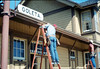 M&M Construction installs new redwood gutters, 5/1988. acc2005.001.0975