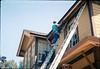 M&M Construction installs new redwood gutters, 5/1988. acc2005.001.0980