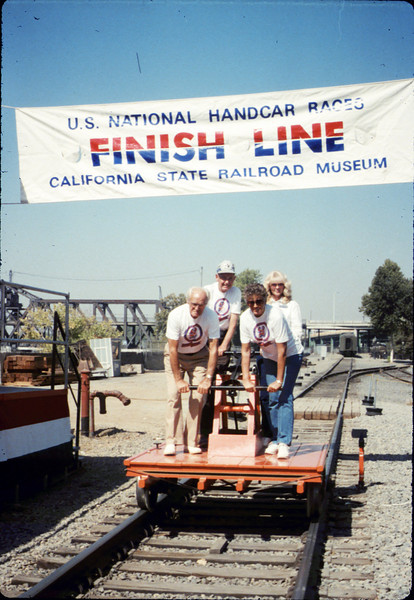 Handcar race team members - George Adams, Anna Dato, Gene Allen, and Phyllis Olsen - at Calif. State Railroad Museum, Sacramento, 9/18/1987 acc2005.001.0869