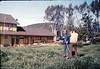 Photographer Paul Heuston captures volunteer Al Jaramillo at work, Work Day, 3/1988. acc2005.001.0905